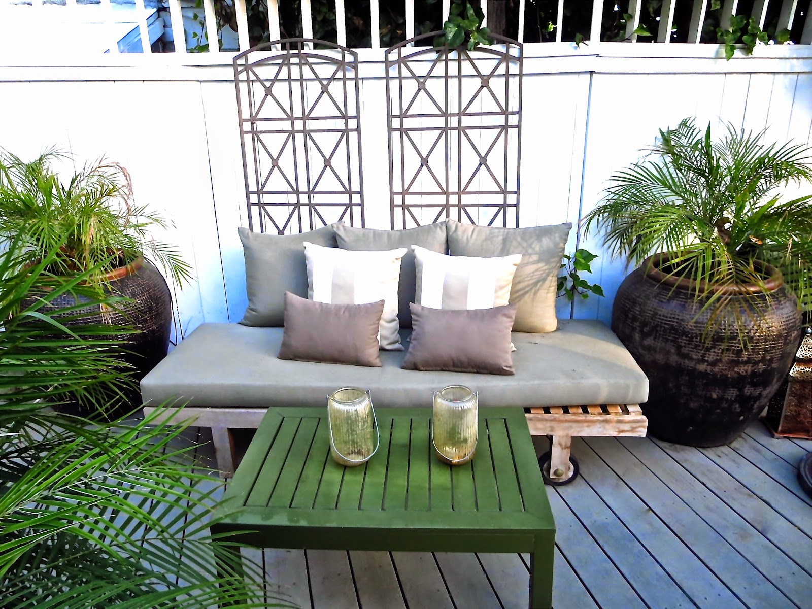 Outdoor deck with neutral color palette and weathered teak furniture