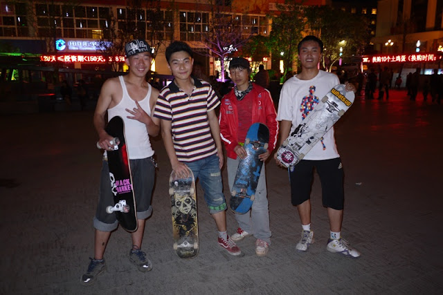 four Chinese skateboarders