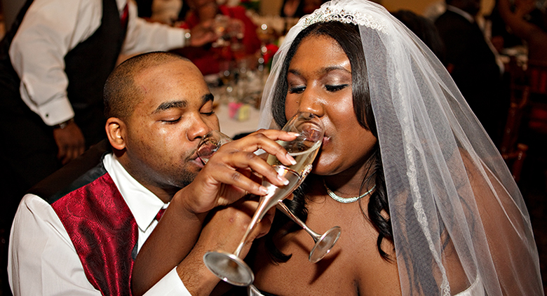 happy couple drinks champagne