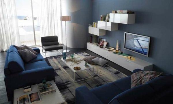 Diseño de sala moderna decorada con paredes en azul celeste que