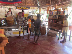 Garifuna drummers and small boys dancing
