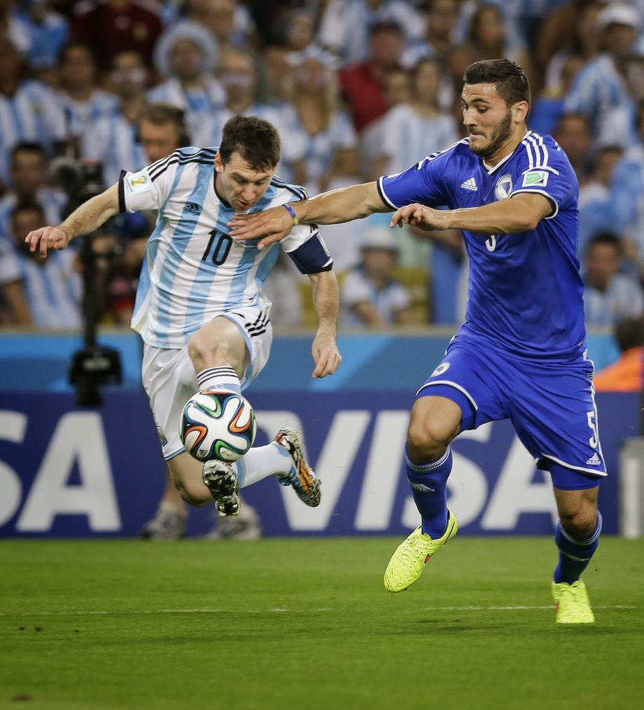 Bosnia's Sead Kolasinac, right, tries to stop Argentina's Lionel Messi (10) during their group F World Cup soccer match at the Maracana Stadium in Rio de Janeiro, Brazil, Sunday, June 15, 2014.