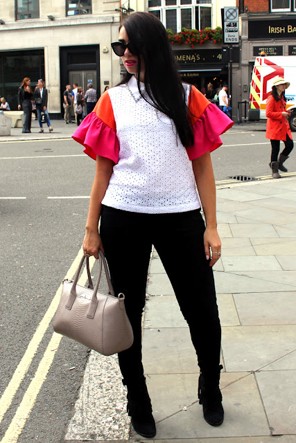 Emma Louise Layla in Cici London ruffle blouse at London Fashion Week