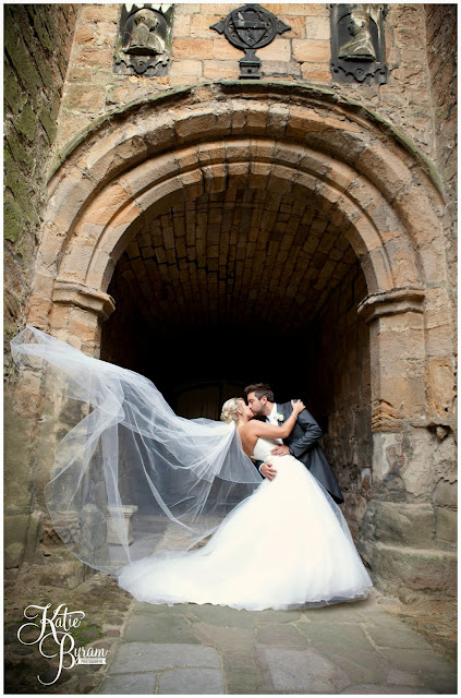 lumley castle wedding, blowing veil, bride and groom kiss, katie byram photography