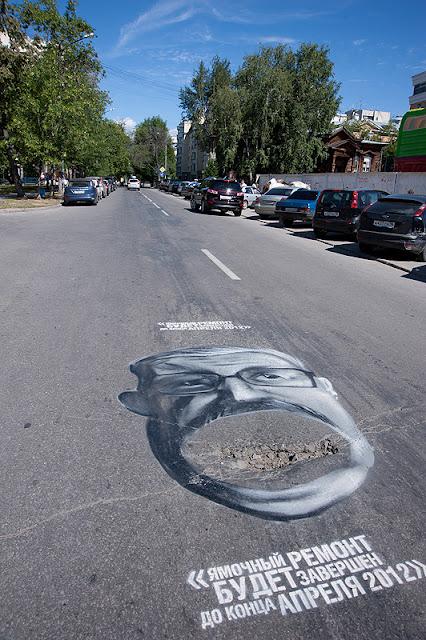 фото на асфальте карикатура на председателя городской думы Екатеринбурга Евгения Порунова