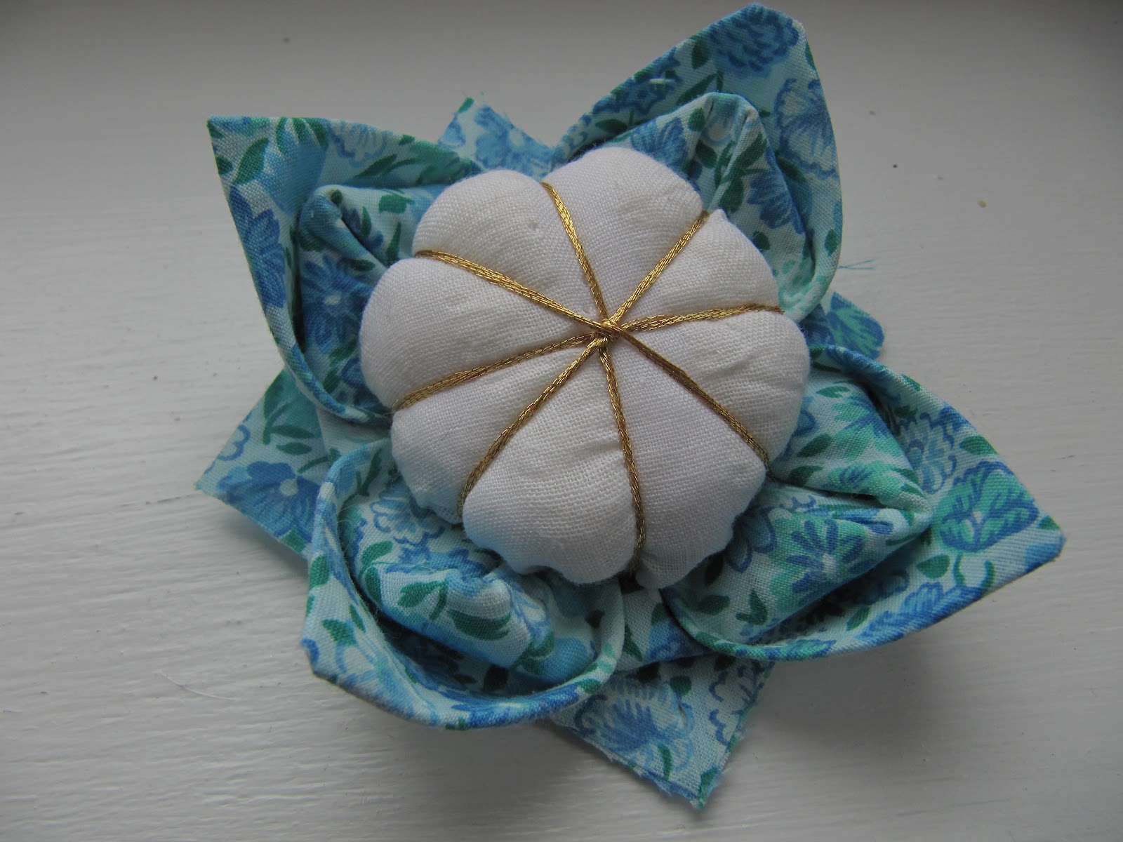 Knotted cotton how to make a fabric origami lotus flower pincushion how to make a fabric origami lotus flower pincushion dhlflorist Image collections