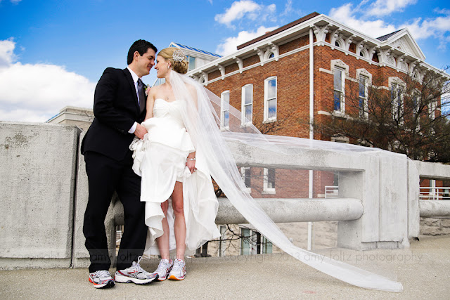 bride and groom in running shoes