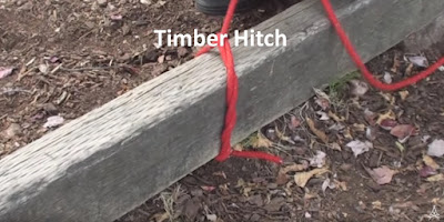 Demonstration of tying a timber hitch on square log