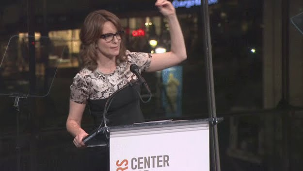 Tina Fey shows with her thumb and forefinger how tiny Todd Akin's peen must be.