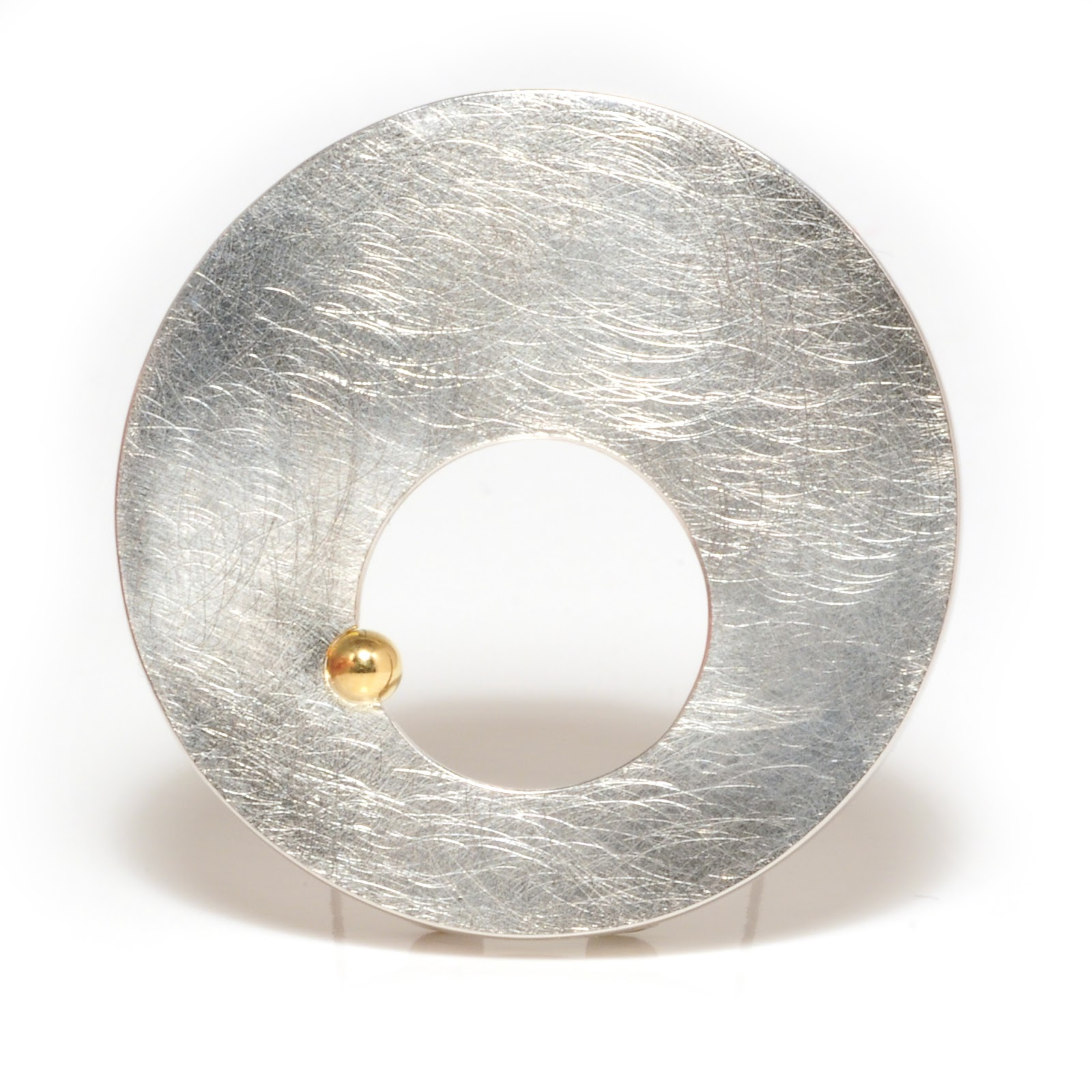 http://www.notonthehighstreet.com/machidewaardjewellery/product/silver-round-brooch-with-open-circle-and-gold-ball