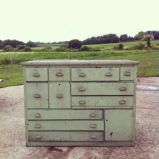 scovill green work bench dresser with one door and 11 drawers of varying size