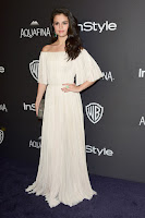 Selena Gomez in a pleated off-the-shoulder gown at the InStyle And Warner Bros. 2016 Golden Globe Awards Post-Party red carpet photo