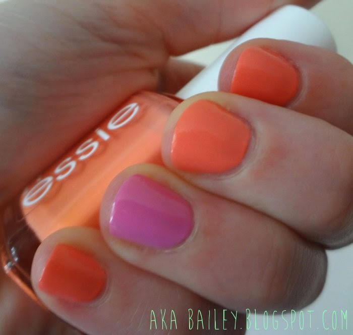 Essie coral nail polish with pink accent nail