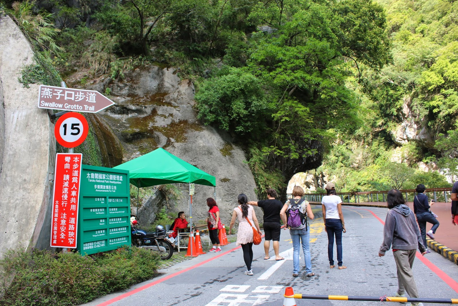 There are signs warning of the danger of rock falls, visitors myst wear helmets before heading to Swallow Grotto Trail at Taroko Gorge National Park in Hualien, Taiwan