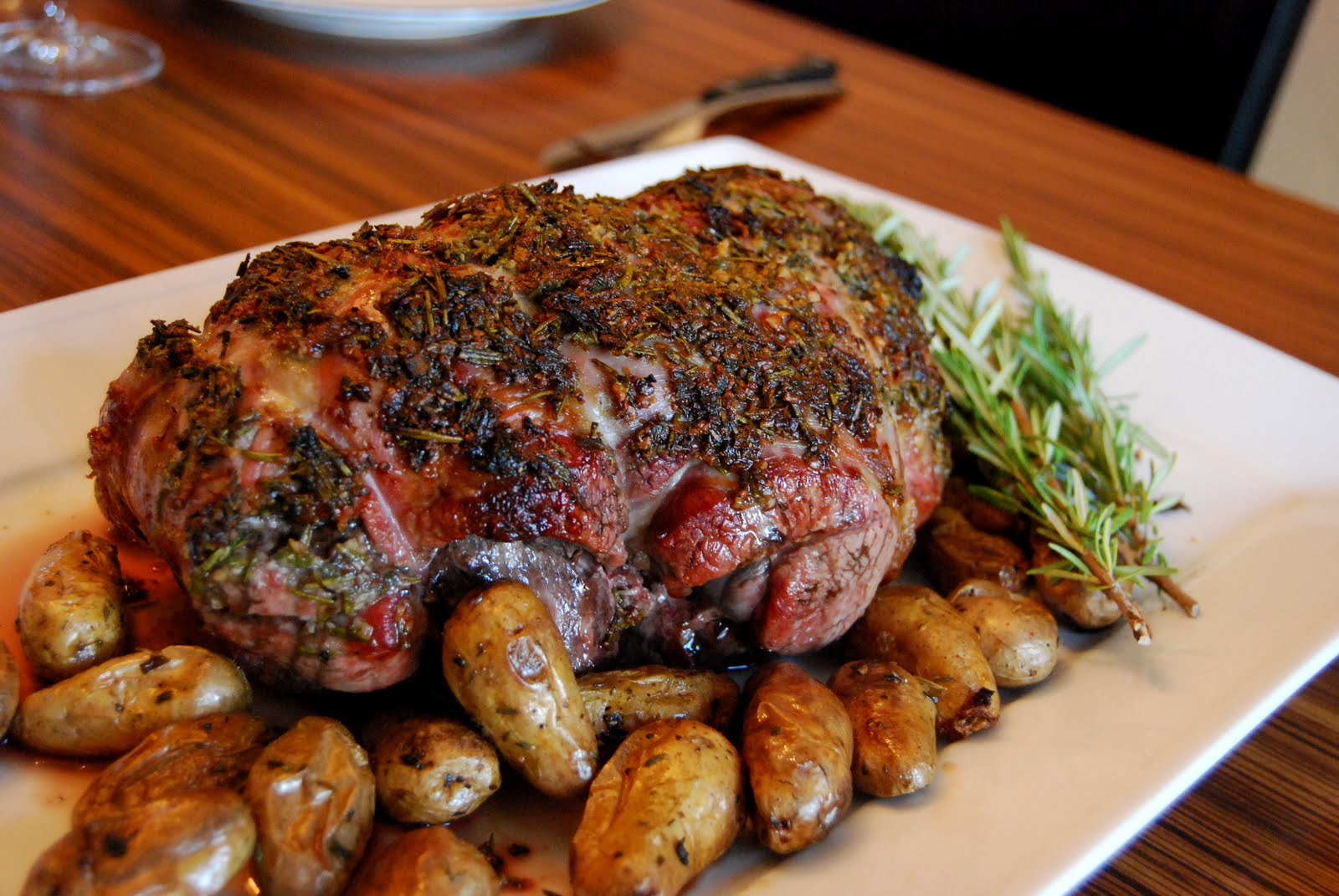 Rosemary and Garlic Roasted Leg of Lamb with Potatoes