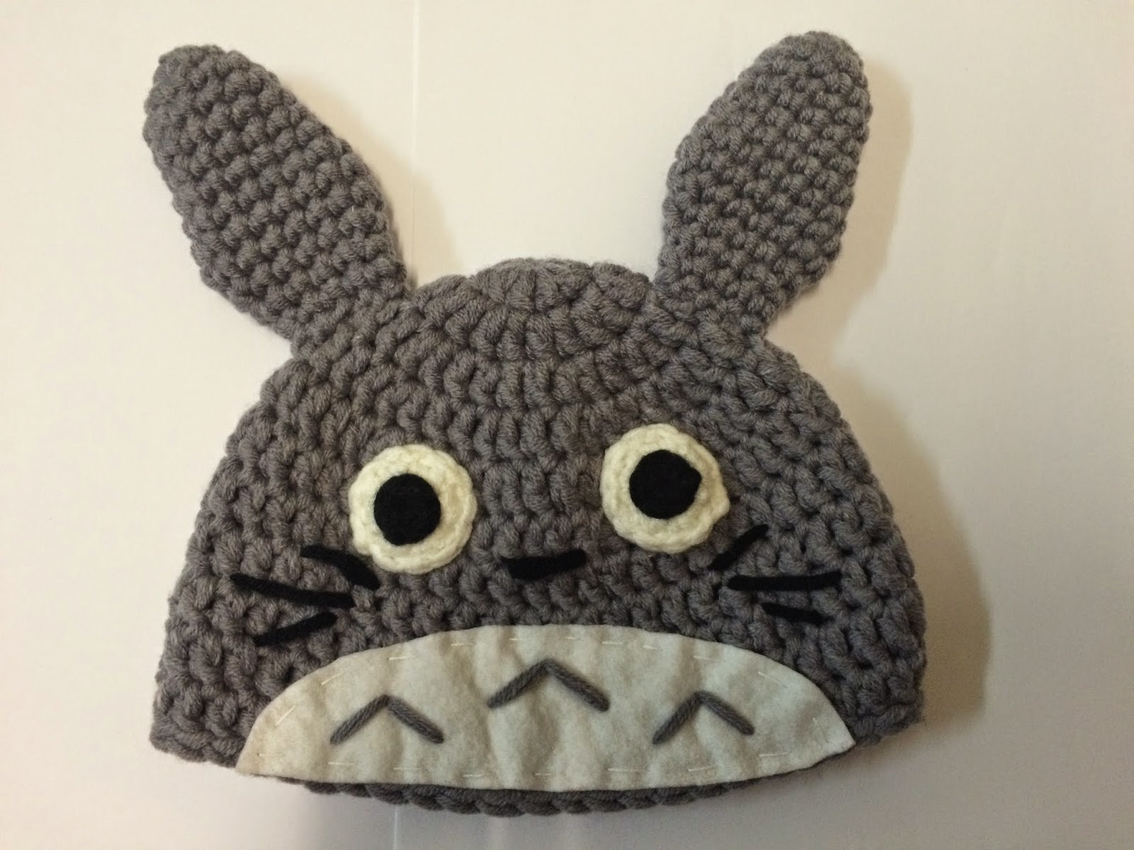 Drunk with caffeine crochet pattern totoro beanie for babies it looks like this when flatten well i dont have a baby at home here so i just stuffed it with some yarn to show how it looked when its a bit bankloansurffo Images