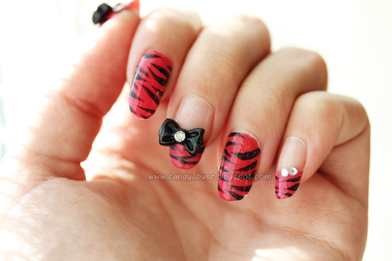 Pink tigerprint nailart with black bows candyabuse cute nailart pink zebra print tiger stripes prinsesfo Images