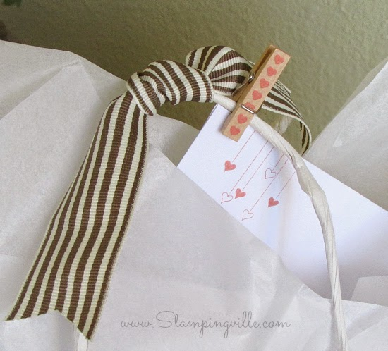Use a mini clothespin to clip card to gift bag handle | Stampingville #papercrafts #cardmaking #babyshower #StampinUp