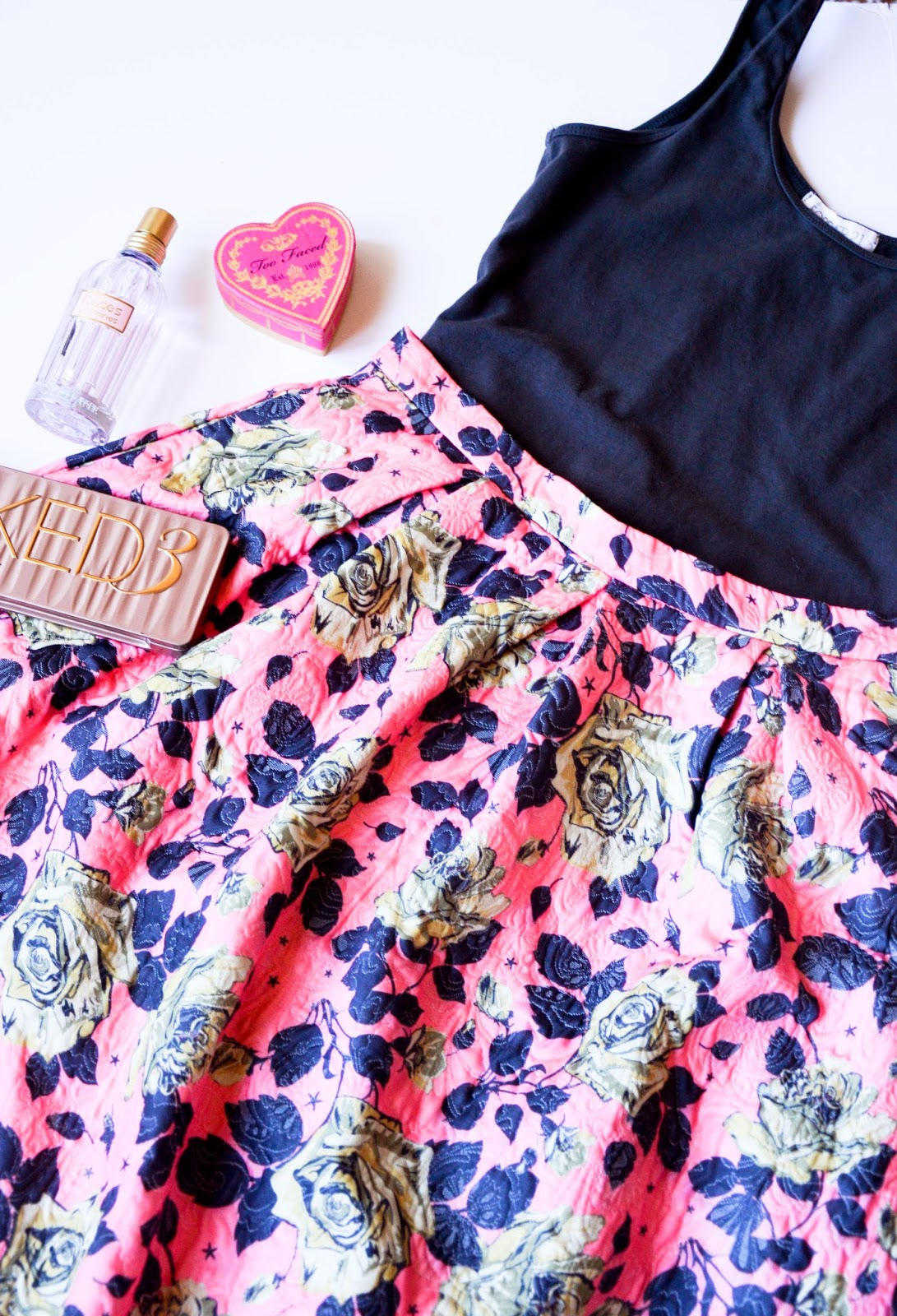 Beauty essentials: L'occitane roses perfume, Too faced heart shaped blush, Urban decay naked 3 eye shadow pallet, pink and gray floral midi skirt from forever21