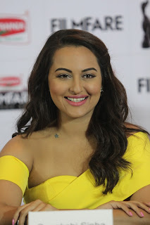 Sonakshi Sinha in an open shoulder Yellow Floor length gown at Britania Filmfare Awards Press Meet