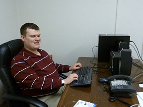 Wesley Majerus working at his computer that aids his visual impairment