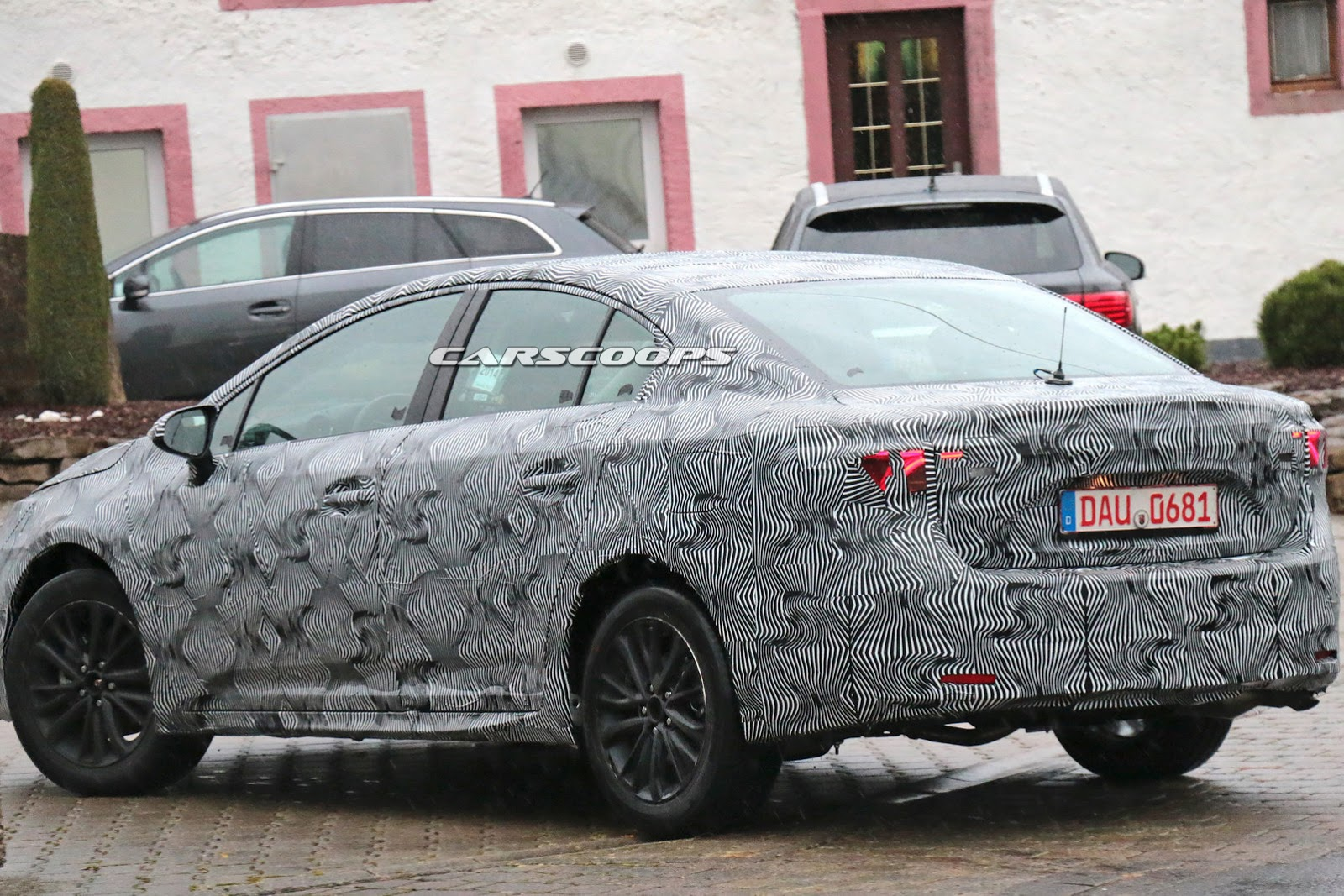 toyota spied testing camouflaged avensis is it a test mule or a facelift carscoops. Black Bedroom Furniture Sets. Home Design Ideas