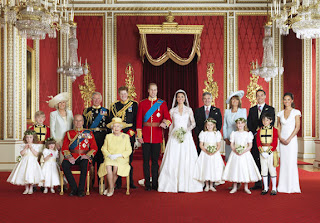 The extended wedding party gather for this magnificent shot in Buckingham Palace.