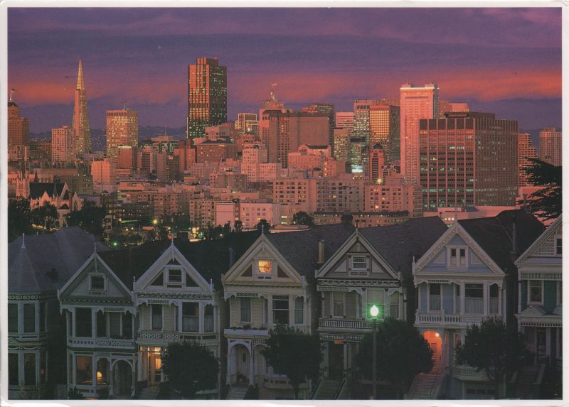 twilight view of city with Victorian houses in the foreground and the modern city centre behind