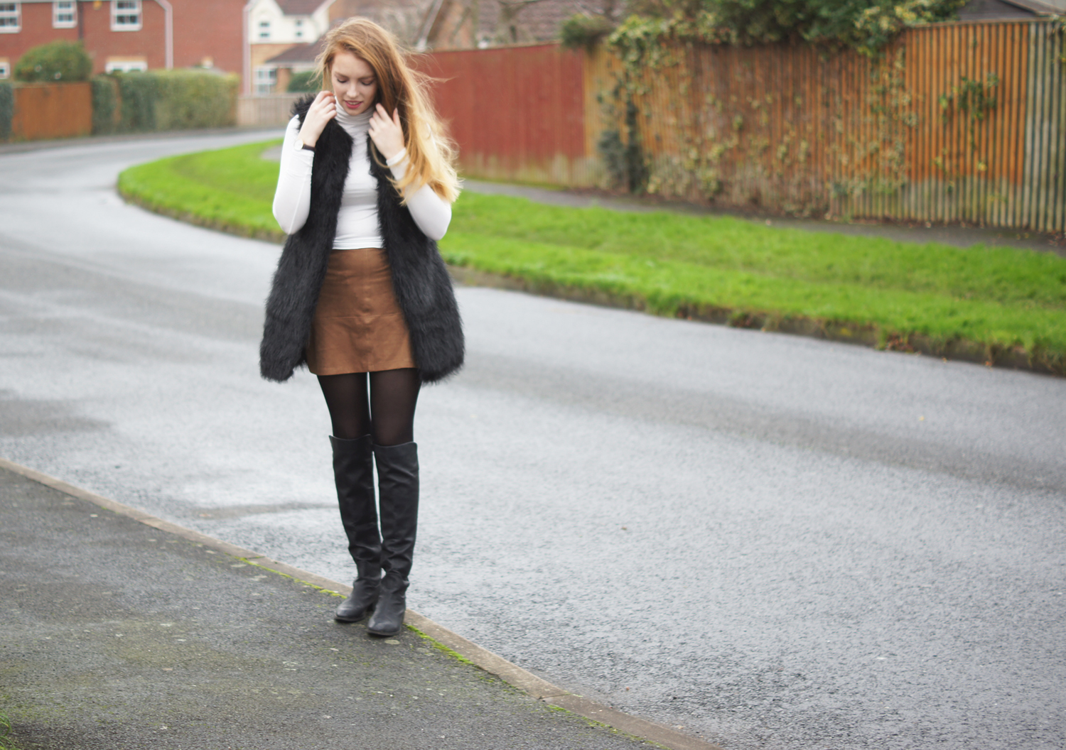 over the knee boots and suede mini skirt