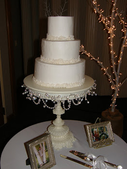 3-tier round buttercream with edible pearls
