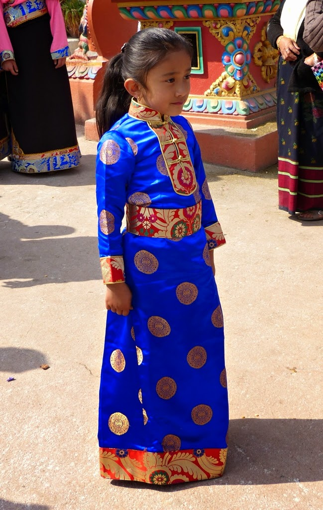 Little girl dressed in beautiful ethnic dress of Tibet