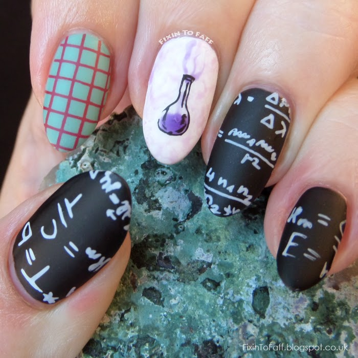 Science and Technology inspired nailart featuring blackboard (chalkboard) nail art with equations, graphing paper, and a chemistry beaker overflowing with purple liquid and smoke.
