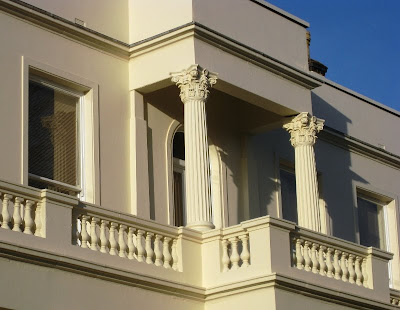 Classic columns and portico against the blue sky