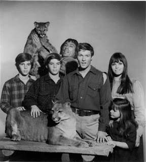 Cast of The Monroes - L to R: Kevin Schultz, Keith Schultz, Ron Sable (with cougar), Michael Anderson Jr, Barabara Hershey and Tammy Locke