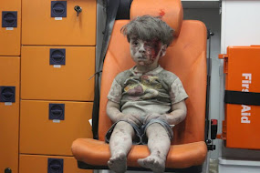 SYRIAN BOY, A DISPLAY OF UNCANNY COURAGE.