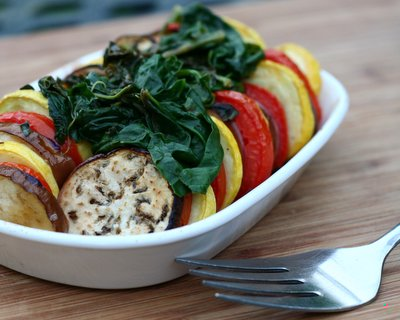 Stacked Ratatouille for One or Two with Spinach ♥ AVeggieVenture.com. Easy, versatile baked eggplant, summer squash and tomato. Low Carb. Paleo. Whole 30. Vegan. WW3.