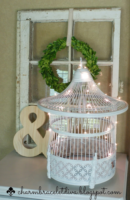 vintage brass bird cage makeover painted white with LED string lights inside