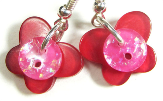 Fun earrings have glitter buttons over red butterfly buttons