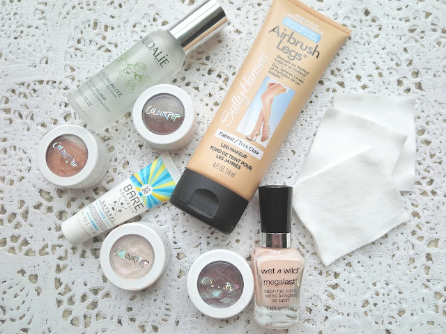 a picture of June Favorites ; ColourPop, Caudalie Beauty Elixir, Sally Hansen Airbrush Leg, Wet n Wild Megalast nail color, Shiseido cotton pads, bare republic SPF 30