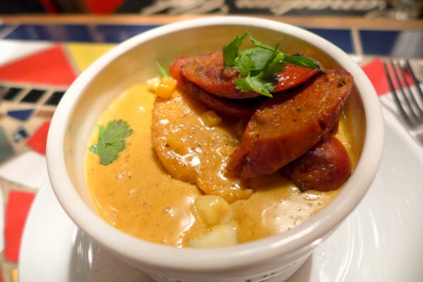 Merguez Curry Apricot Poutine - Bistro Coq Licorne Gatineau