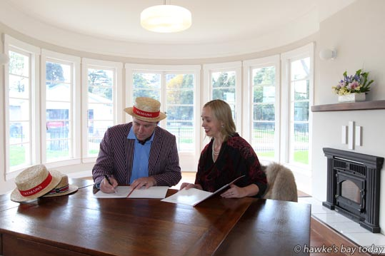 L-R: Simon Tremain, managing director, Tremain Real Estate, Sally Jackson, general manager, Art Deco Trust, signing another three year major sponsorship of Art Deco Weekend, pictured in the historic, newly-named The Art Deco House, former private residence of Hawke's Bay architect Harold George Davies, near Cornwall Park, Hastings. photograph