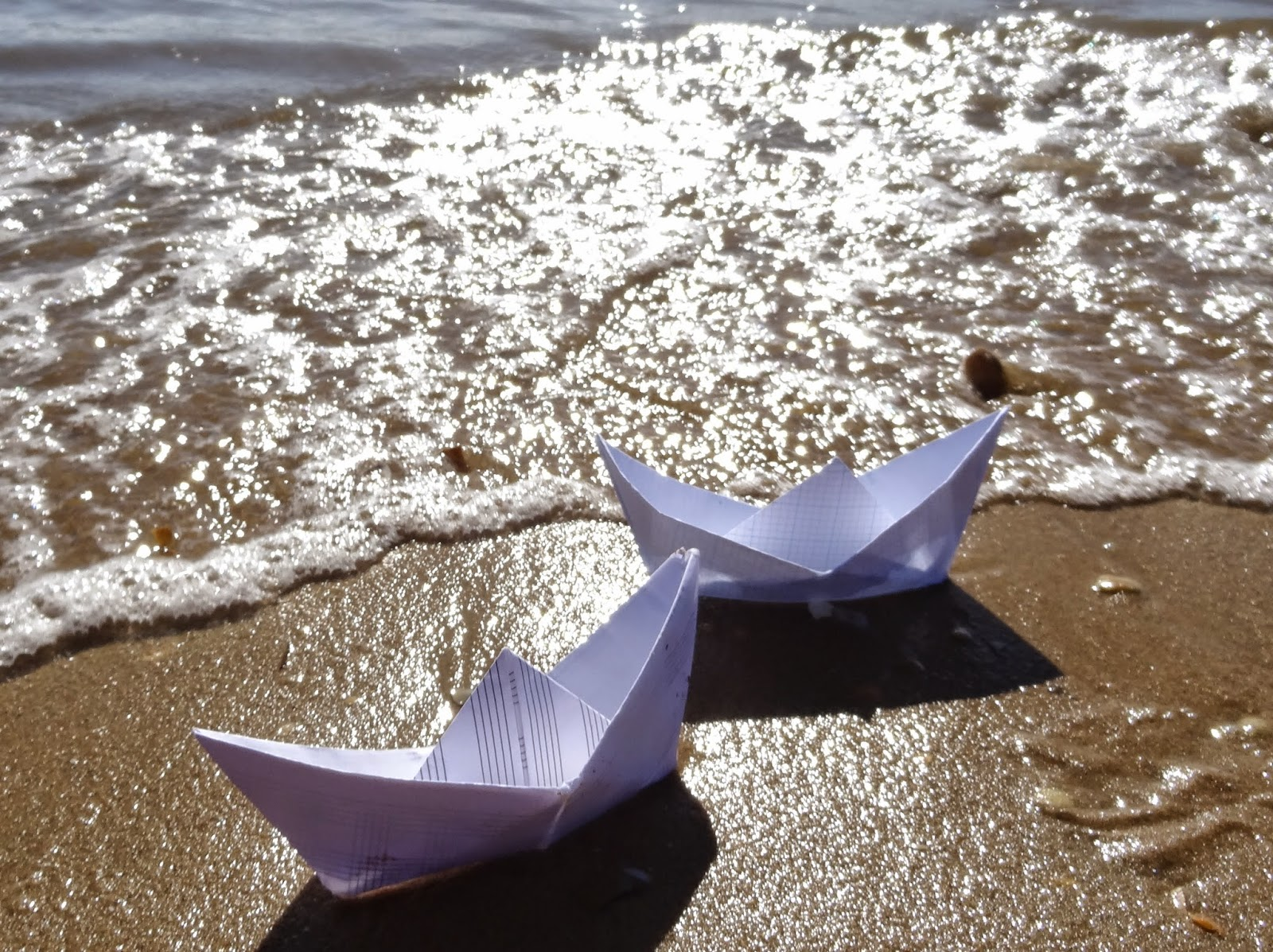 waves paper boat