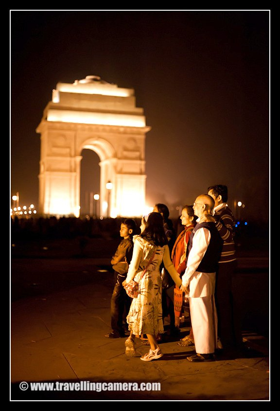 A Family having group Photograph at India Gate in Delhi !!! I liked the composition of this family having two children, their parents and grand-parents together in a happy pose... India Gate is very popular place for spending evenings in Delhi and in summers crowd increases suddenly as the area around it is airy because of lot of green areas around it. And India Gate area is very less populated as compared to other parts of Delhi !!! There are some huge grounds around India Gate and people come here with prepared dinner and spend their evening and go back late night !! Then time for young groups starts and lot of people can be seen hanging around till 1:00 am...