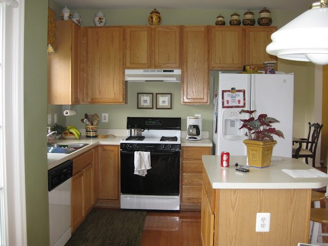 kitchen with laminate counters and oak cabinets before being painted and transformed.