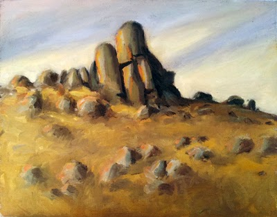 Oil painting of granite boulders surrounded by dry grass, illuminated by the late afternoon sun.