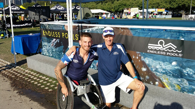 Paratriathlete Joe Townsend and Endless Pools' John Lee at the Endless Pools booth at the ITU World Triathlon Grand Final Chicago.