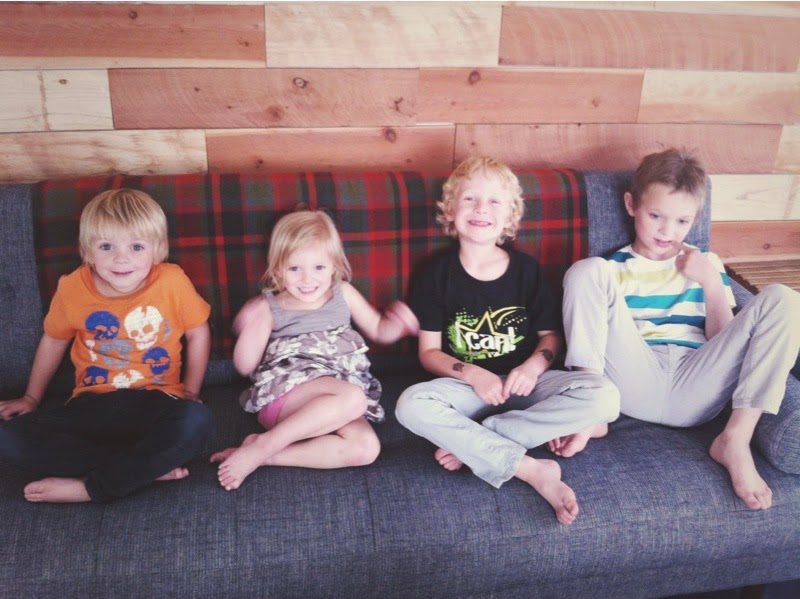 four kids on a couch