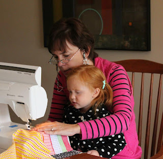 photo of: Granny Glasses and Little Red Spend the Day Sewing
