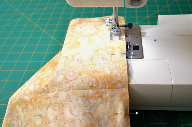 Fabric on the sewing machine, stitching the side seams.