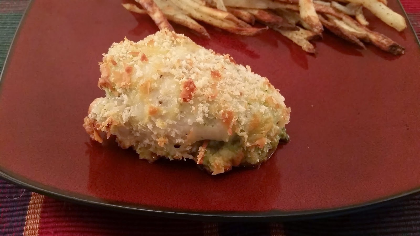 Pesto stuffed chicken thighs. Coated with panko and parmesan. Ready to eat!! Click for recipe.